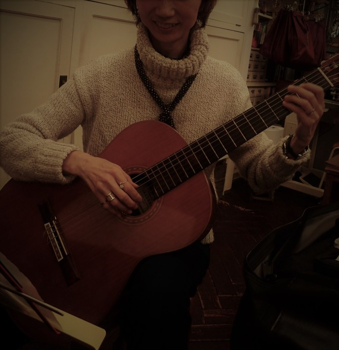 Miyo plays the guitar